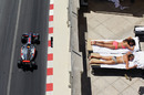 Lewis Hamilton passes a couple of sunbathers