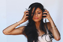 Nicole Scherzinger listens in on the pit-to-car radio