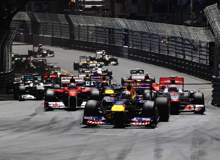 Sebastian Vettel leads Jenson Button into the first corner
