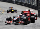 Jenson Button leads Fernando Alonso into Sainte Devote early in the race