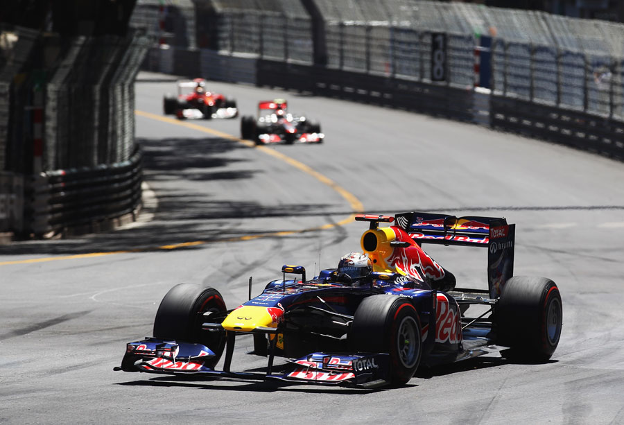 Sebastian Vettel takes an early four second lead over Jenson Button and Fernando Alonso