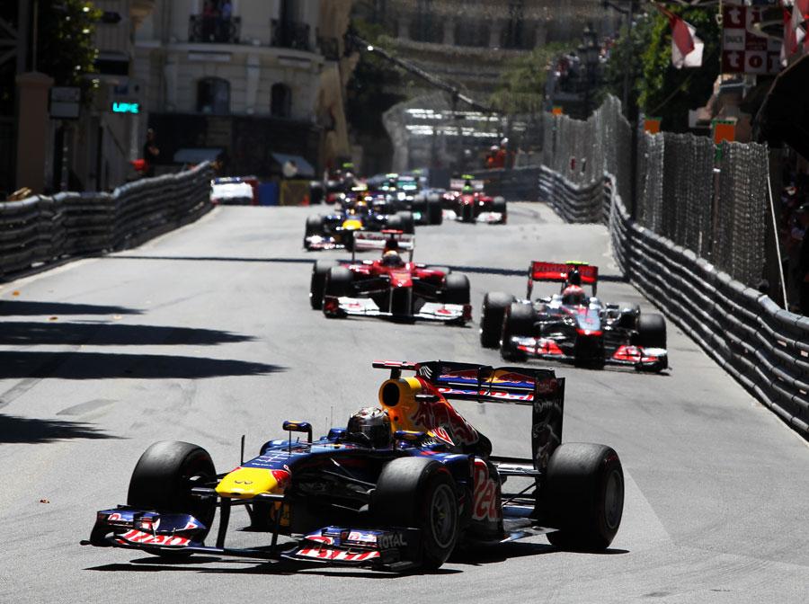 Sebastian Vettel leads the field ithrough Mirabeau on lap one