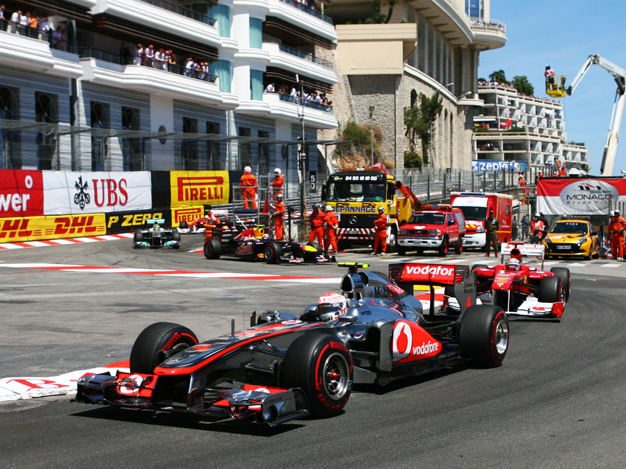 Jenson Button leads Fernando Alonso through the Nouvelle Chicane