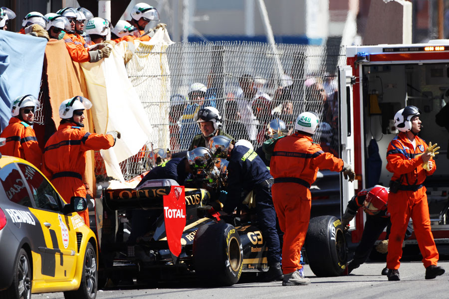 Medics work to remove Vitaly Petrov from his car