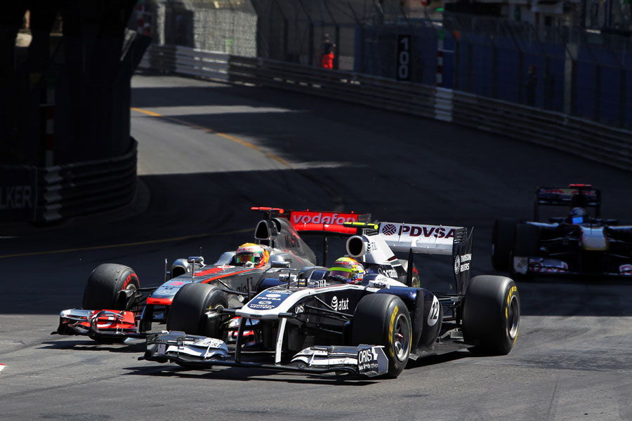 Lewis Hamilton attempts to make a move up the inside of Pastor Maldonado into turn one