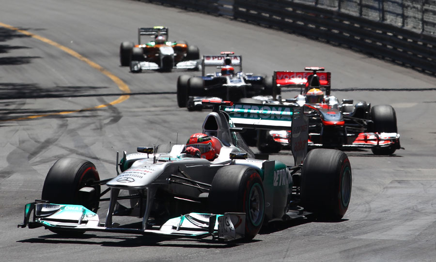 Michael Schumacher leads Lewis Hamilton in the early stages