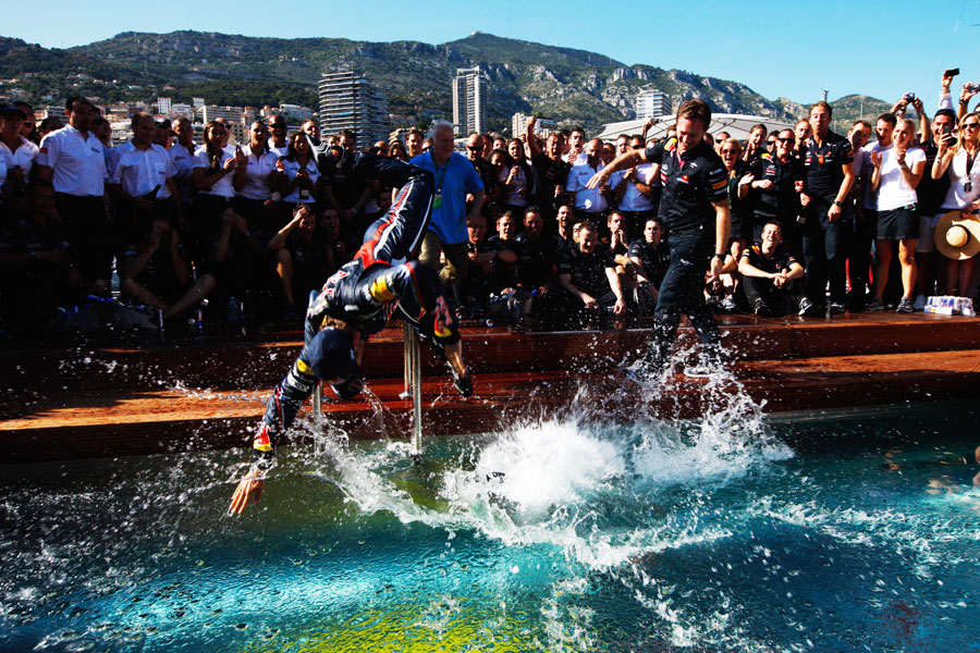 Sebastian Vettel dives into the Red Bull swimming pool
