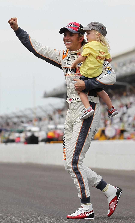 Dan Wheldon celebrates winning the Indianapolis 500