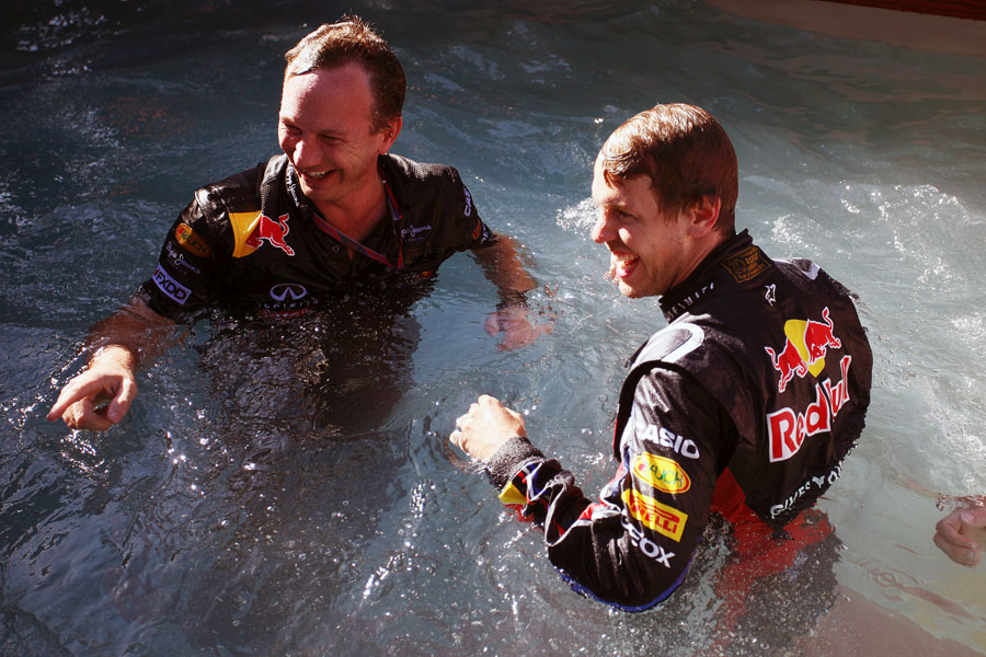 Sebastian Vettel and Christian Horner celebrate in the Red Bull swimming pool