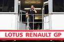 Eric Boullier makes a call above the Renault garage