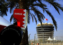 A model of a Formula 1 car is displayed in front of the Bahrain International Circuit tower