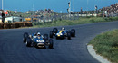 Jack Brabham closes the door on Jim Clark