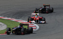 Vitaly Petrov heads Felipe Massa and Nick Heidfeld