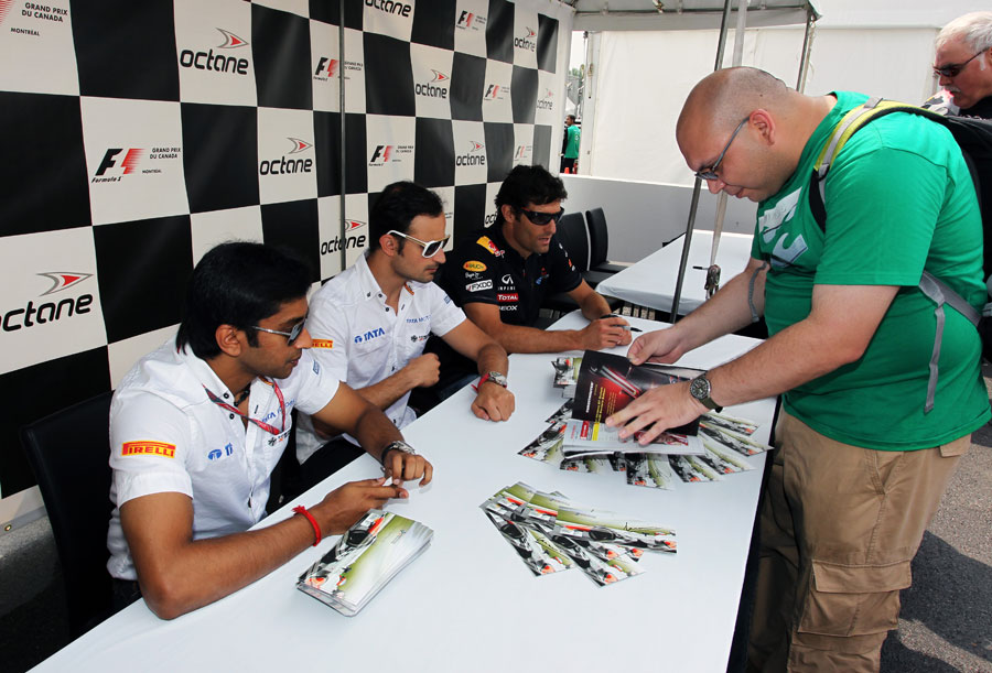 Narain Karthikeyan, Tonio Liuzzi and Mark Webber sign autographs for fans