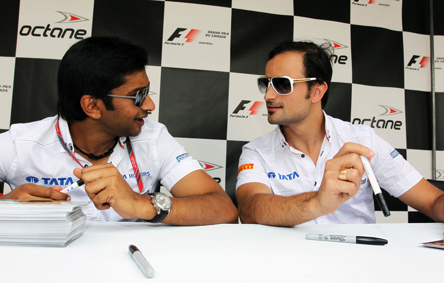 Narain Karthikeyan and Tonio Liuzzi compare sunglasses at the signature session