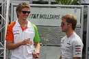 Nico Hulkenberg and Sam Bird chat in the paddock