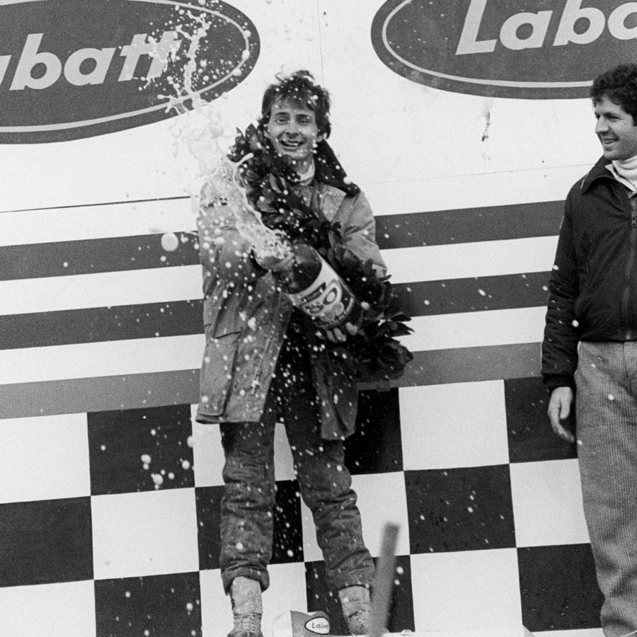 Gilles Villeneuve sprays beer on the podium