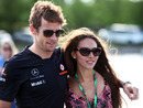 Jenson Button arrives in the paddock with girlfriend Jessica Michibata on Friday morning