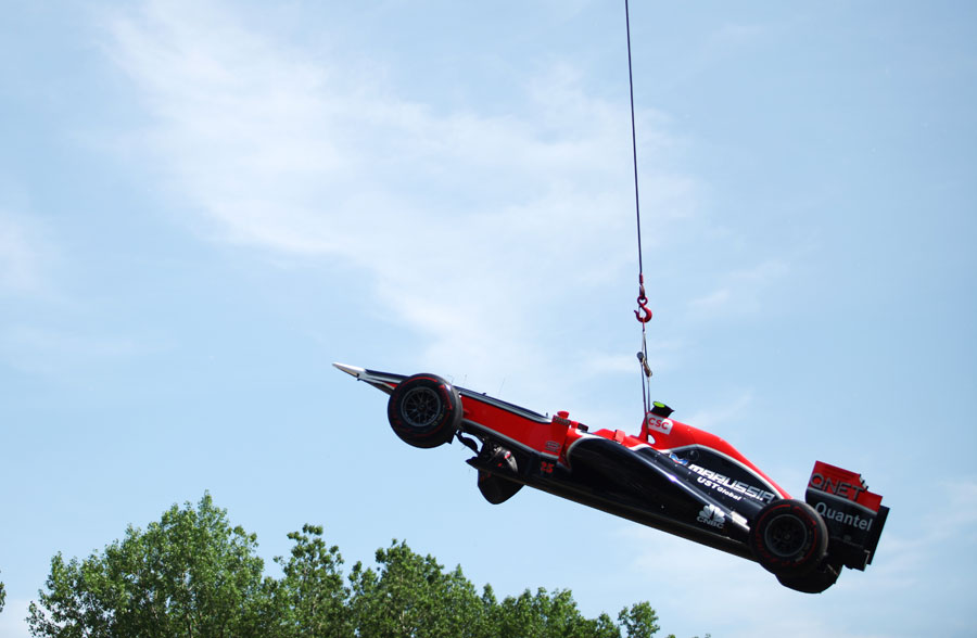 Jerome d'Ambrosio's Virgin is lifted away after his accident in second practice