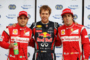 Sebastian Vettel celebrates his pole position with Fernando Alonso and Felipe Massa