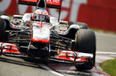Jenson Button attacks the kerbs in his McLaren