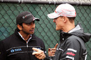 Narain Karthikeyan and Michael Schumacher chat ahead of the race