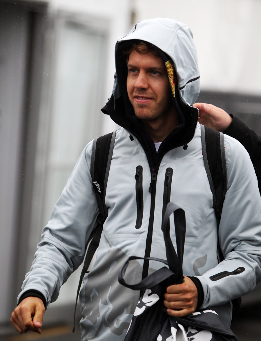 Sebastian Vettel shelters from the rain