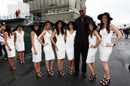 Grid girls pose with NBA basketballer Andrew Bynum