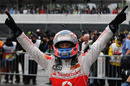 Jenson Button celebrates his remarkable victory