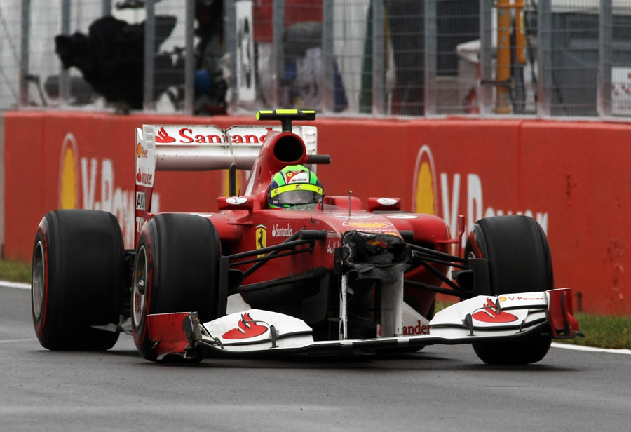Felipe Massa races back to the pits for a new nose after hitting the wall while trying to overtake a backmarker