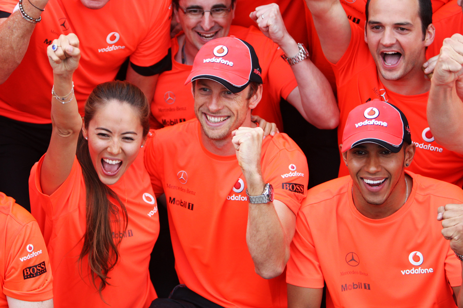 Jenson Button celebrates his remarkable victory with girlfriend Jessica Michibata and Lewis Hamilton