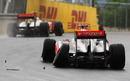 Jenson Button speeds away while Lewis Hamilton limps into retirement after their collision