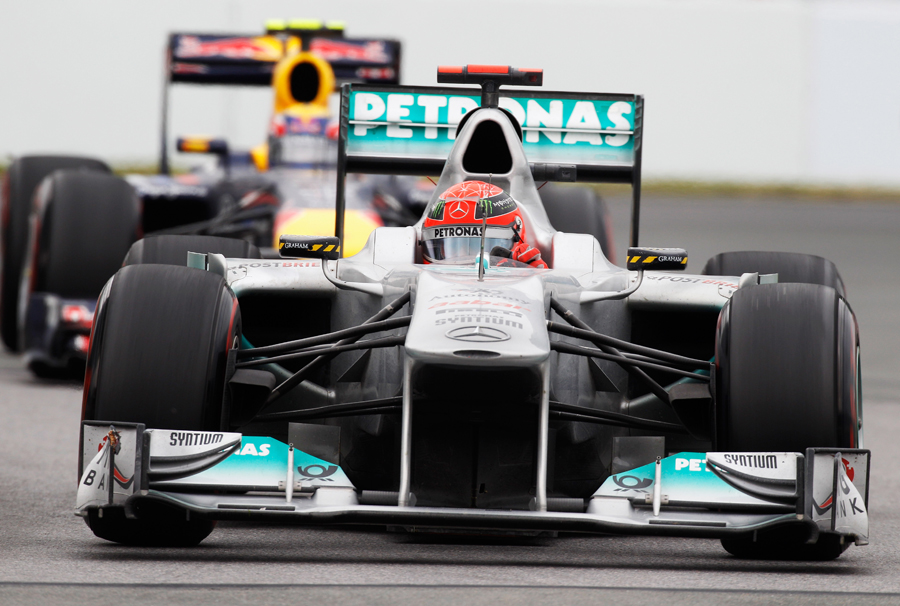 Michael Schumacher holds off Mark Webber