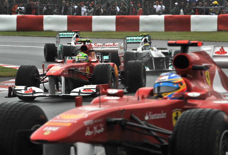 Fernando Alonso runs wide as Felipe Massa holds off the Mercedes