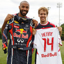 Footballer Thierry Henry and Sebastian Vettel swap a shirt for a racesuit following a training session with the New York Red Bulls