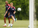 Thierry Henry gives Sebastian Vettel some tips during a training session with the New York Red Bulls