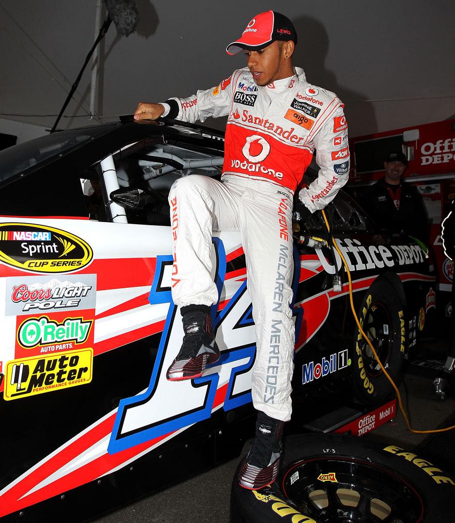 Lewis Hamilton climbs into Tony Stewart's NASCAR