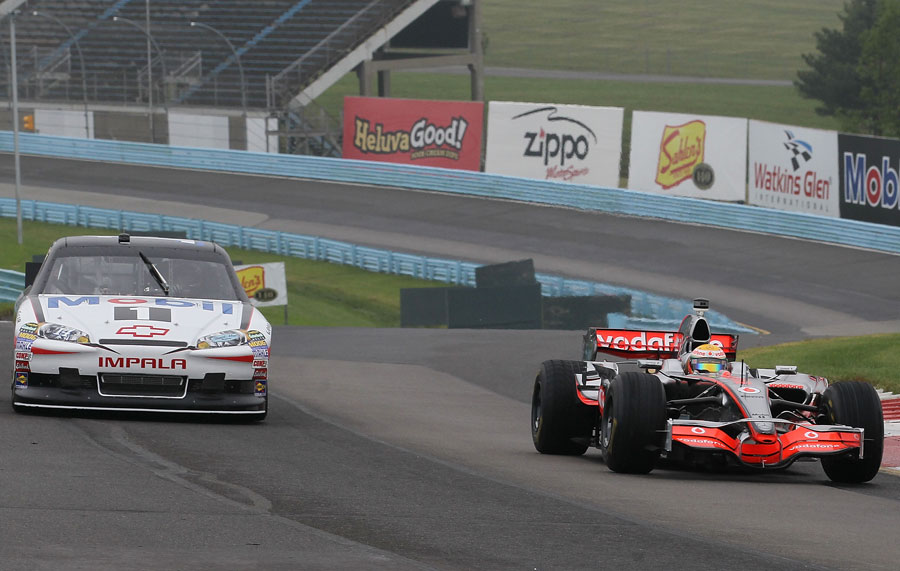 Lewis Hamilton leads the way during a demonstration with NASCAR driver Tony Stewart