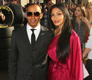 Lewis Hamilton and girlfriend Nicole Scherzinger arrive at the premiere of Cars 2
