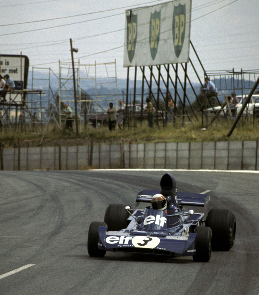 Jackie Stewart slides his Tyrrell towards victory