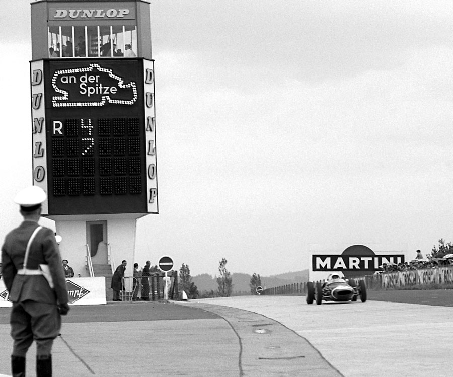 Stirling Moss on his way to victory ahead of the Ferraris