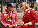 Niki Lauda and James Hunt talk on the pit wall