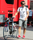 Timo Glock arrives in the paddock with his bike