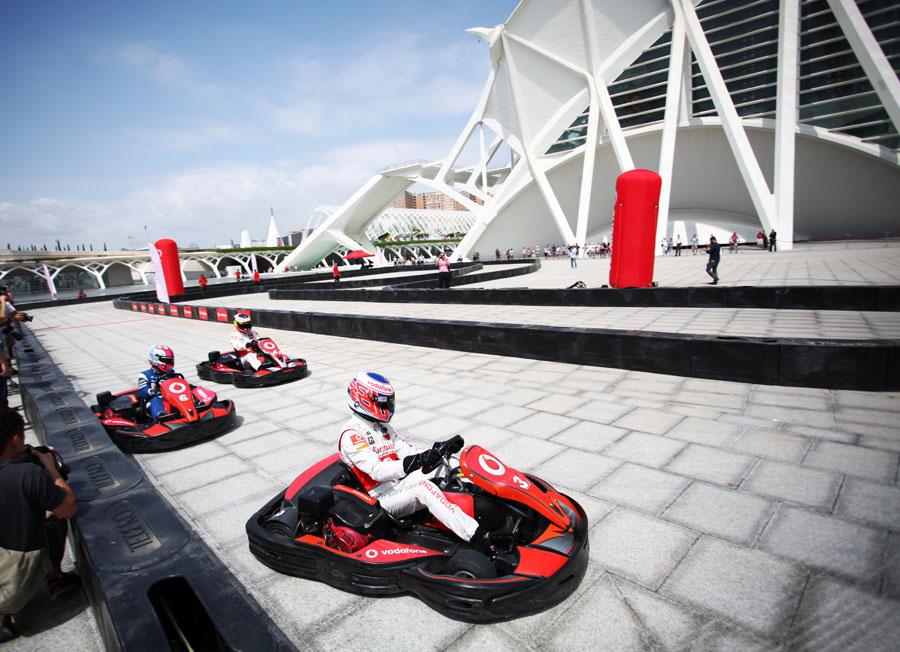 Jenson Button, Maximo Cortes and Pedro de la Rosa take part in a karting event at the Ciudad de las Artes y las Cliencias