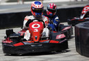 Jenson Button leads Maximo Cortes in a karting event for sponsors Vodafone
