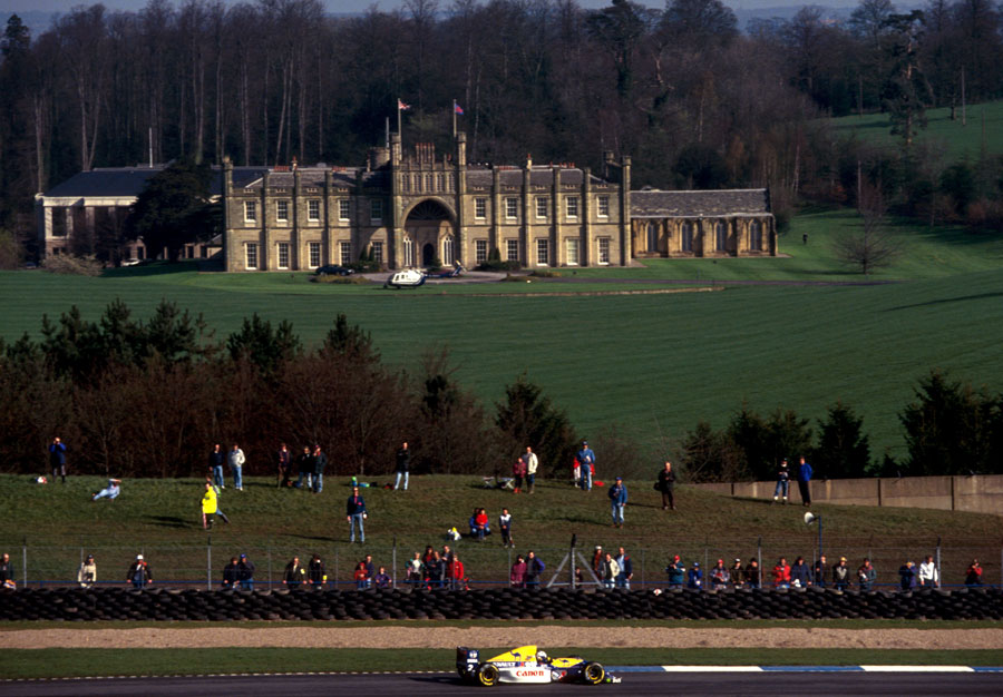 Alain Prost speeds past Donington Hall