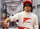 Fernando Alonso relaxes at the back of the garage
