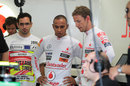 Jenson Button and Lewis Hamilton chat in the McLaren garage