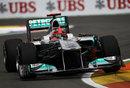 Michael Schumacher clips the apex