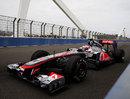 Jenson Button crosses the swing bridge